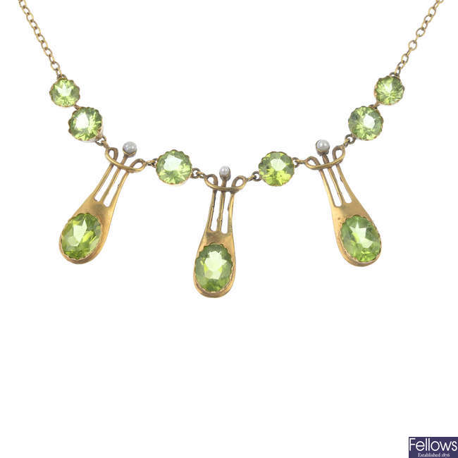 A peridot fringe necklace and matching earrings.