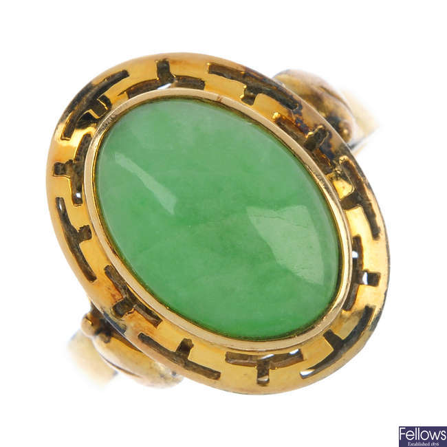 A jade ring and a pair of jade ear pendants.