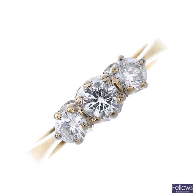 An 18ct gold diamond three-stone ring.