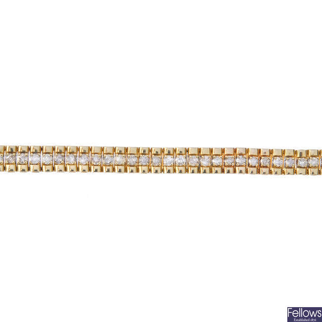 A 9ct gold diamond bracelet.