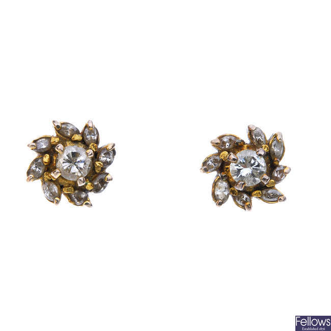 Two pairs of diamond ear studs.