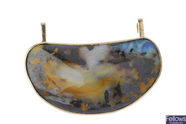 An 18ct gold boulder opal pendant.