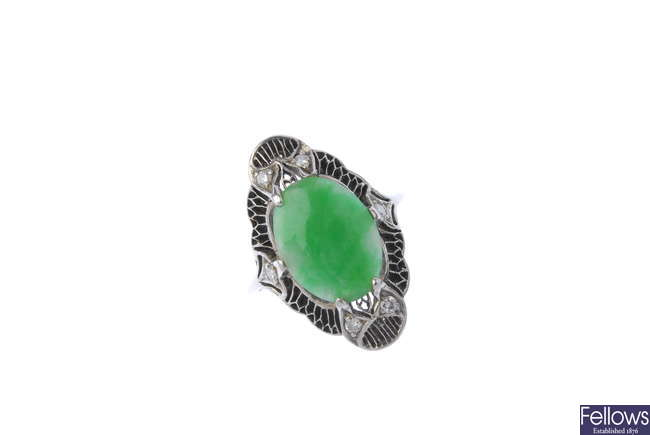 A mid 20th century gold and platinum jade dress ring.