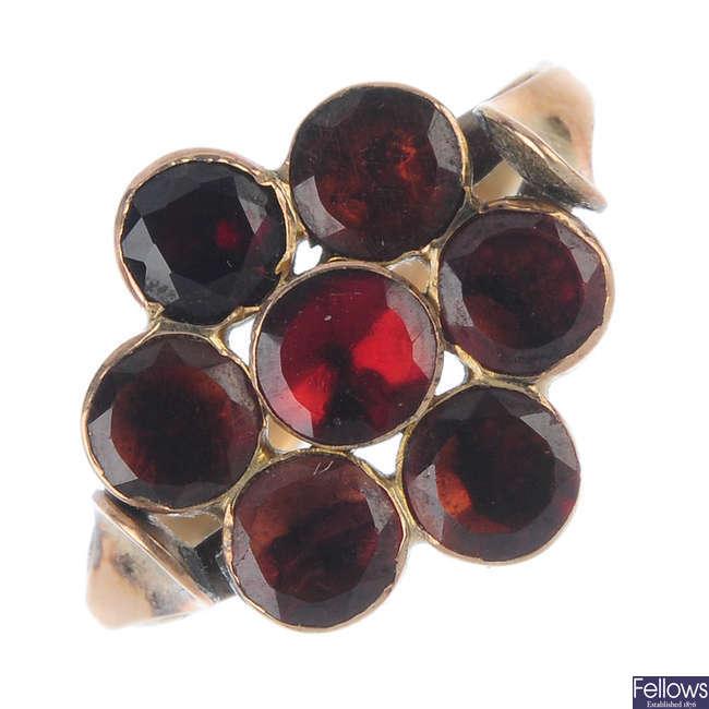 A garnet floral cluster ring.