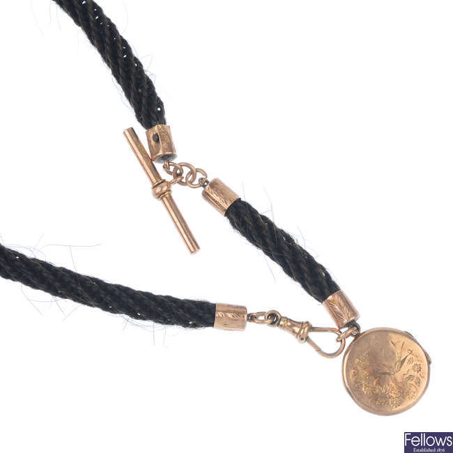 A late Victorian hair chain and 9ct gold locket.