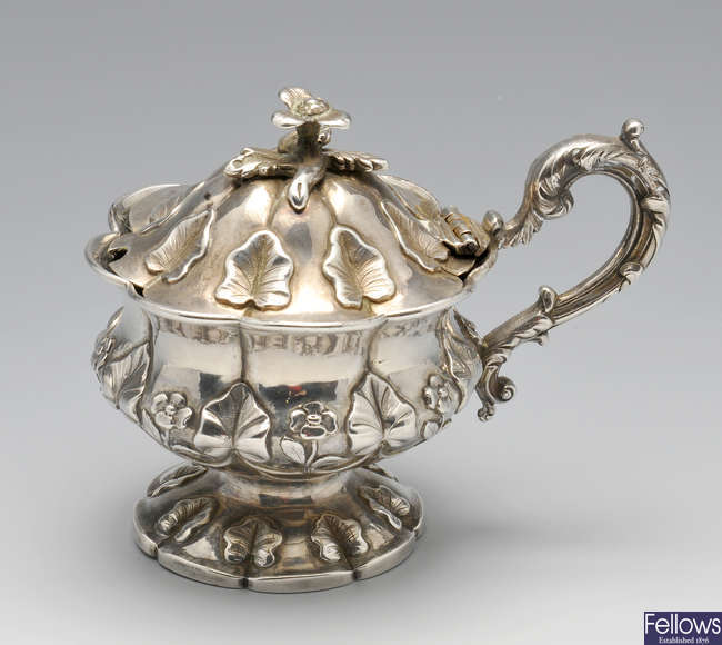 A William IV silver mustard pot.