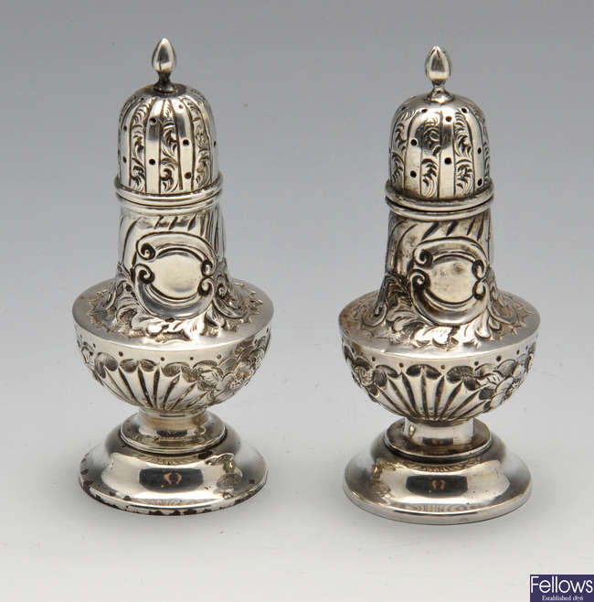 A pair of late Victorian silver pepper pots.