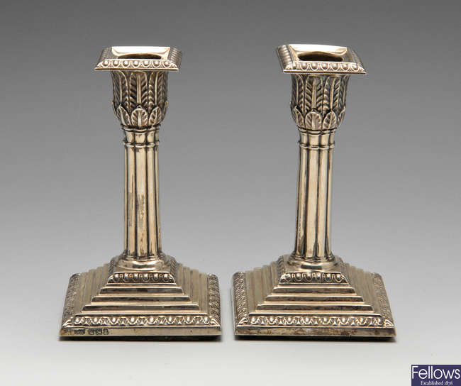 A pair of late Victorian silver candlesticks.