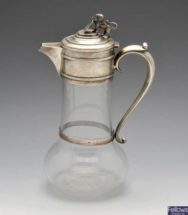 A late Victorian silver mouted glass claret jug.