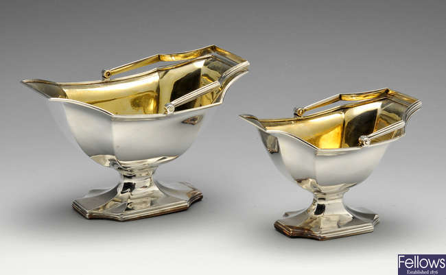 Two George III silver graduated sugar baskets.