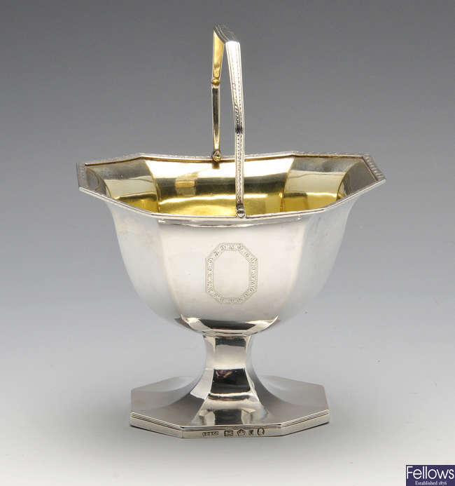 A George III silver sugar basket.