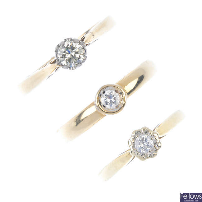 A selection of three 9ct gold diamond single-stone rings.
