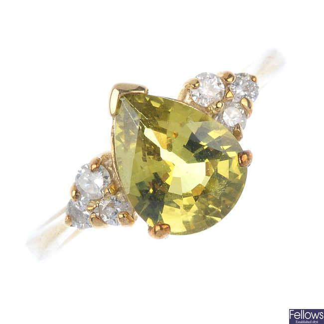 A 9ct gold chrysoberyl and diamond ring.