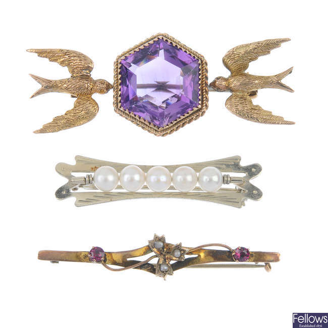A selection of three gem-set brooches.