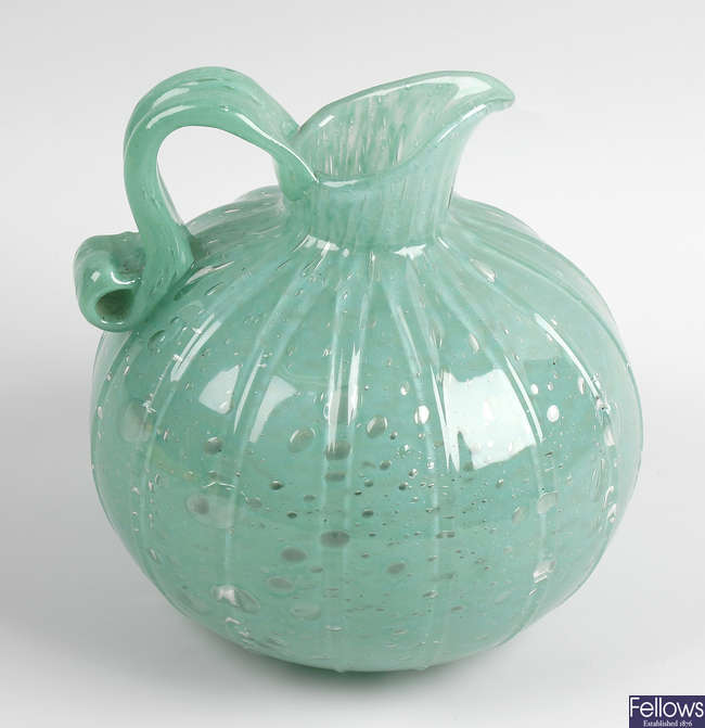 A French Art Deco style green glass jug