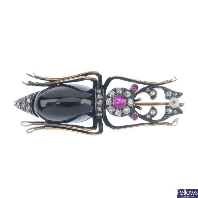 An early 20th century Russian gold diamond and gem-set stag beetle brooch.