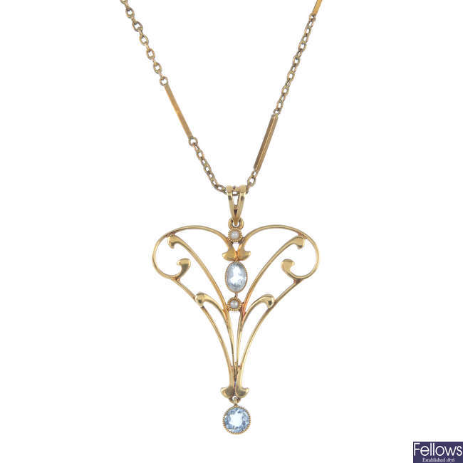 An early 20th century 15ct gold gem-set pendant and 9ct gold chain.