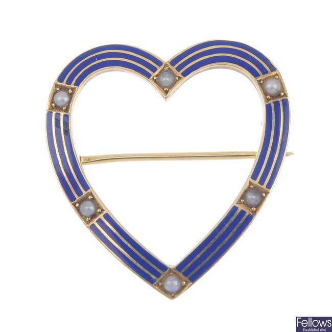 A mid 20th century enamel and split pearl heart brooch.