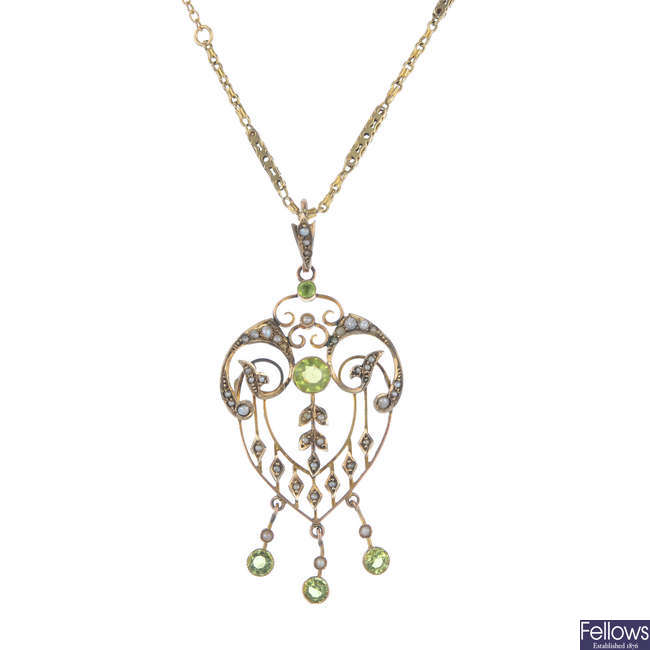 An early 20th century 9ct gold garnet-topped-doublet and split pearl pendant, with later chain.