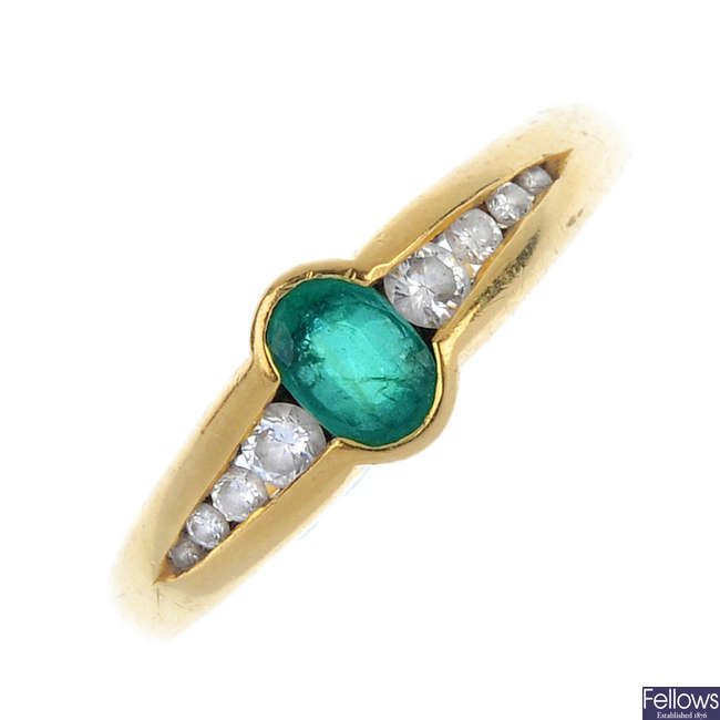 An 18ct emerald and diamond ring.