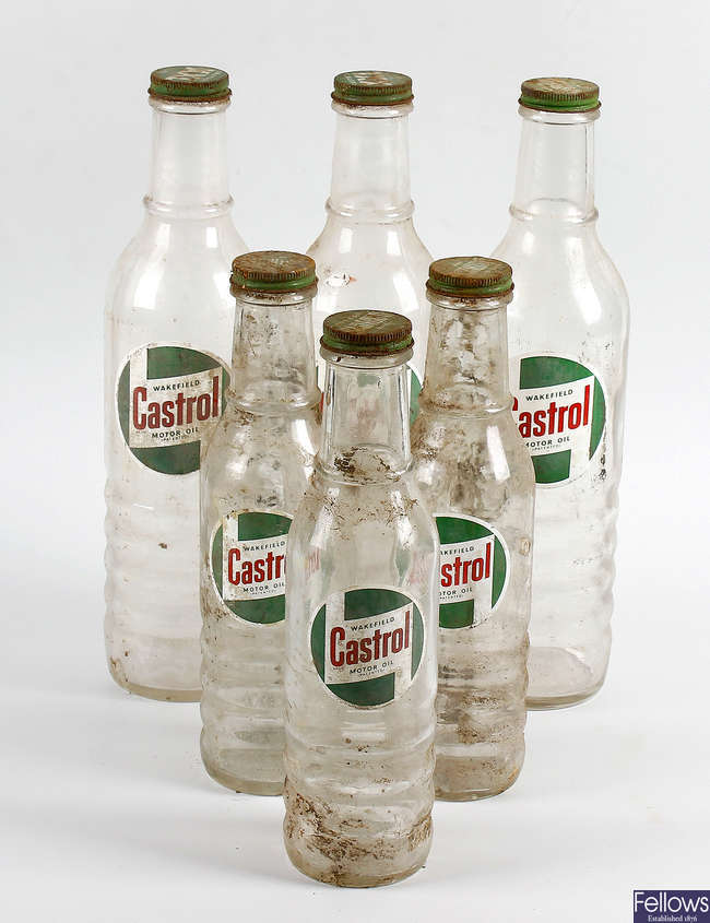 A collection of 21 assorted Castrol motor oil glass bottles