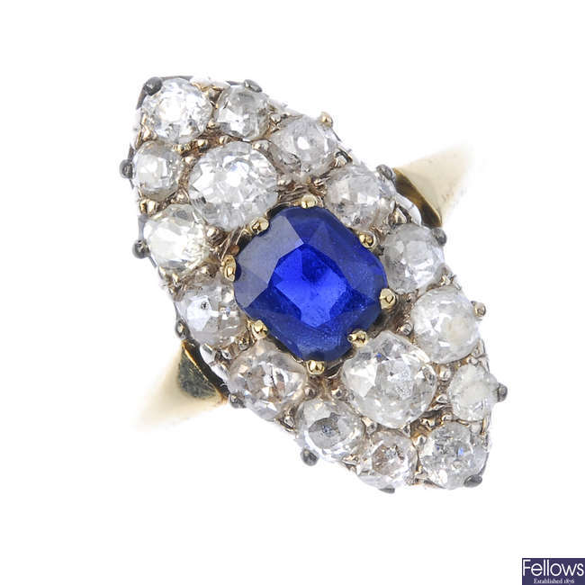 A sapphire and diamond marquise cluster ring.