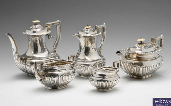 An Edwardian five piece silver tea service.
