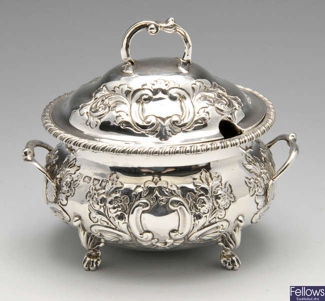 A late Victorian two handled silver sauce tureen and cover.