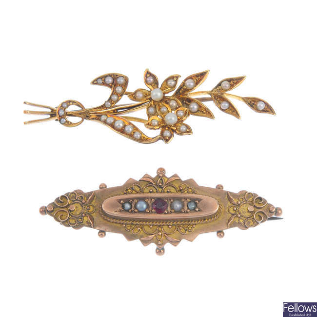 A selection of four brooches.