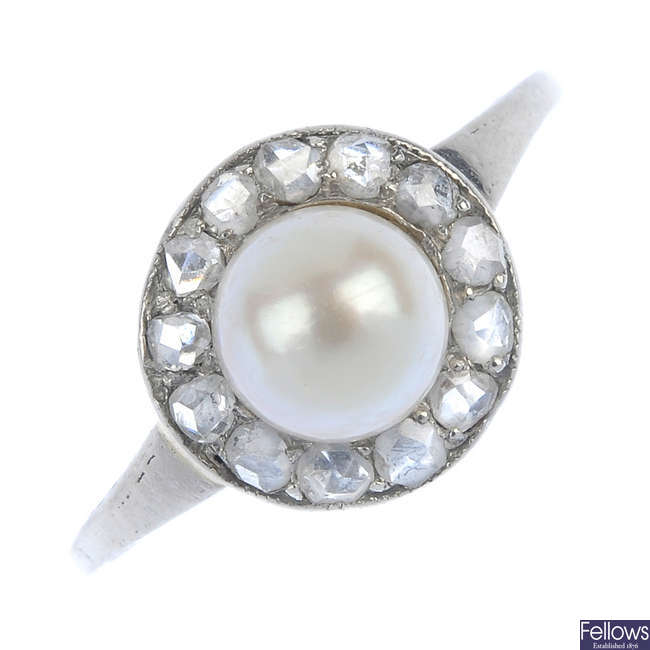 An early 20th century platinum cultured pearl and diamond cluster ring.