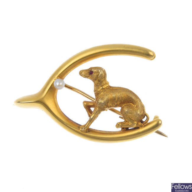 An early 20th century 15ct gold seed pearl dog and wishbone brooch.