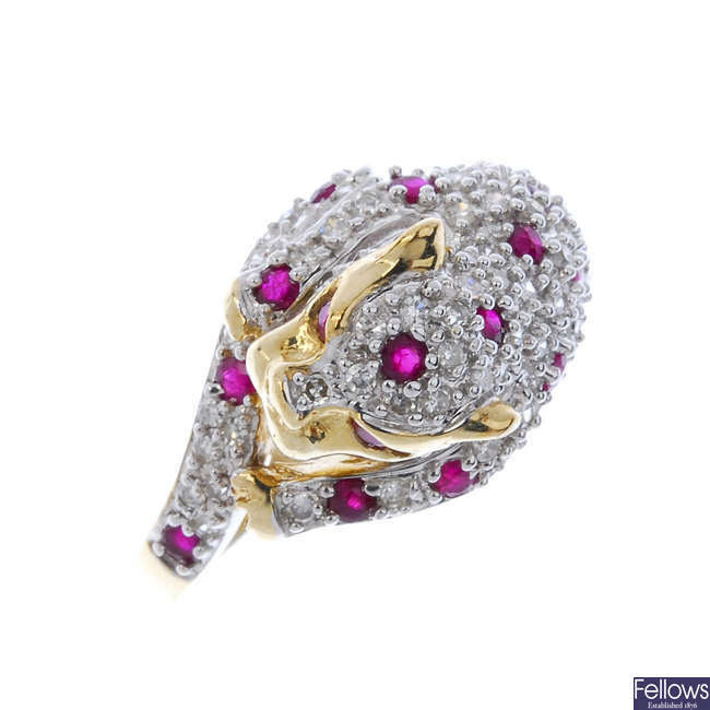 A 9ct gold ruby and diamond leopard ring.