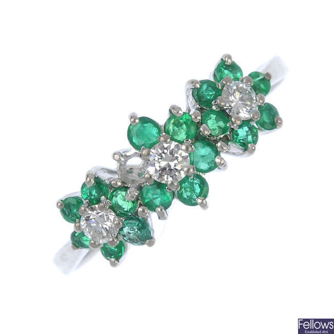 An 18ct gold emerald and diamond triple cluster ring.