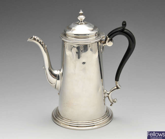 An Edwardian silver coffee pot.