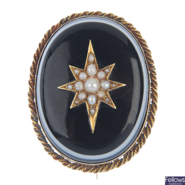 A late 19th century gold split pearl and onyx mourning brooch.