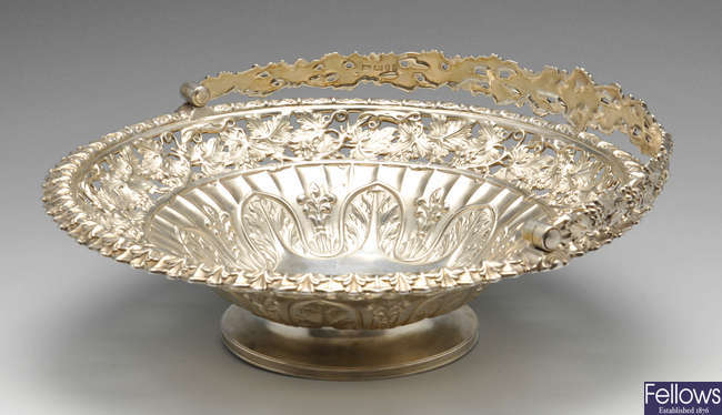 A George IV silver swing handle basket.