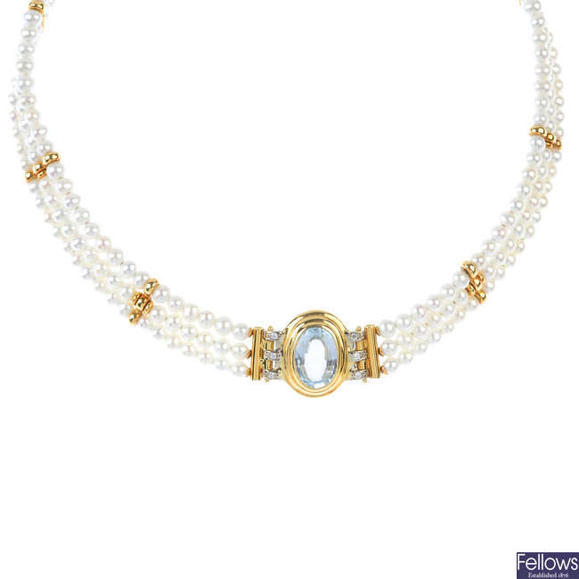 A topaz, diamond and cultured pearl collar.