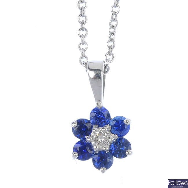 An 18ct gold sapphire and diamond cluster pendant, with chain.