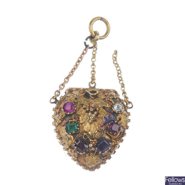 A mid 19th century gold gem-set 'regard' heart locket.