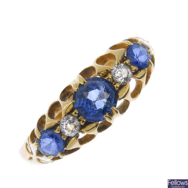 An Edwardian 18ct gold sapphire and diamond ring.