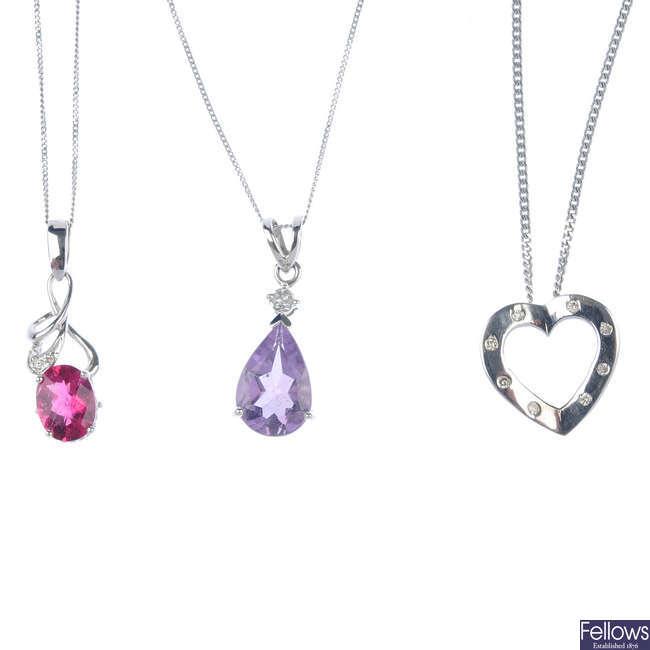 A selection of three 9ct gold gem-set pendants.