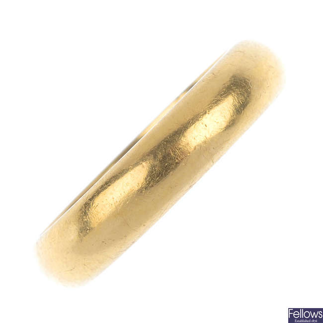 A 1960s 22ct gold band ring.