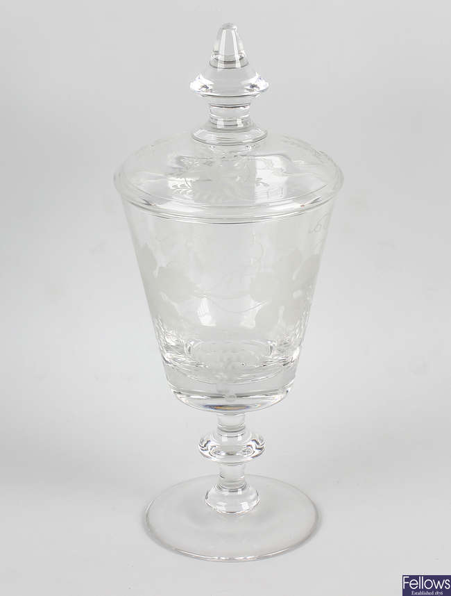 An etched glass pedestal vase and cover.