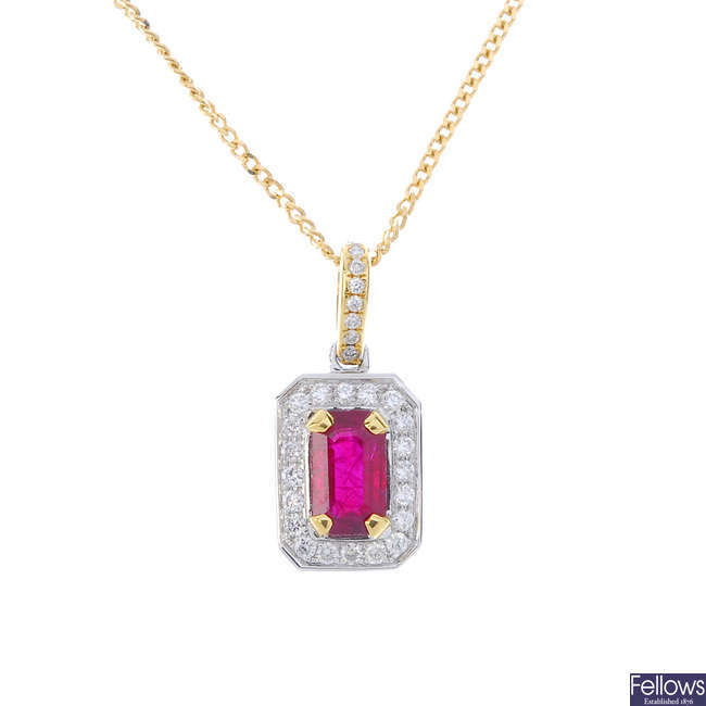 An 18ct gold ruby and diamond cluster pendant, with chain.