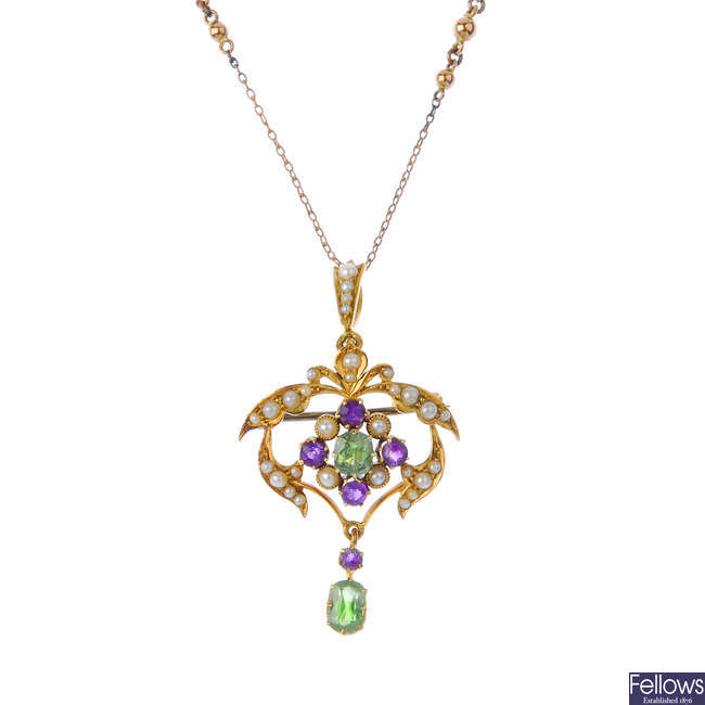 An early 20th century 15ct gold demantoid garnet, amethyst and split pearl pendant, with chain.