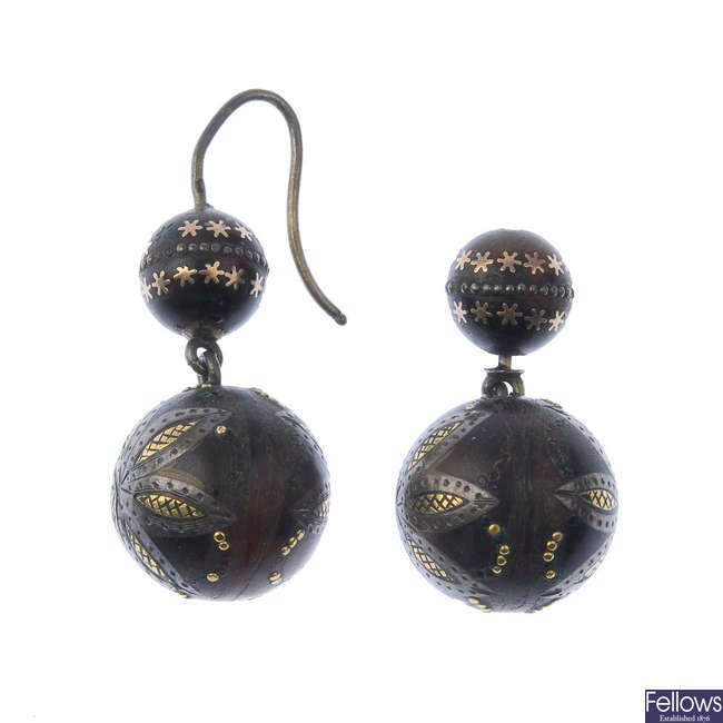 A pair of late 19th century pique tortoiseshell ear pendants. One AF.