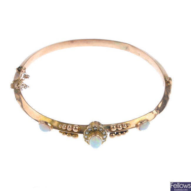 A late Victorian 9ct gold opal and split pearl hinged bangle.