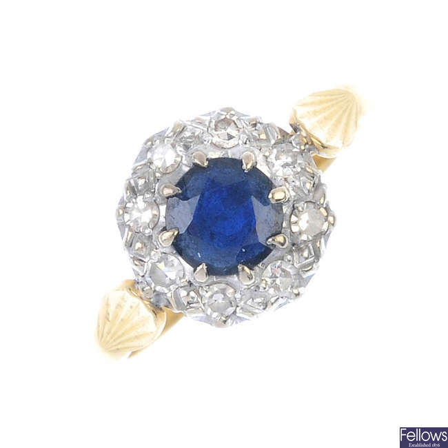 A mid 20th century 18ct gold sapphire and diamond cluster ring.