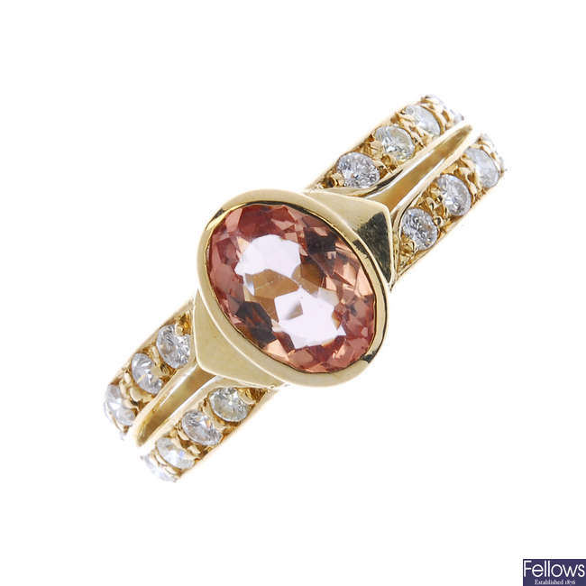 A topaz and diamond dress ring.