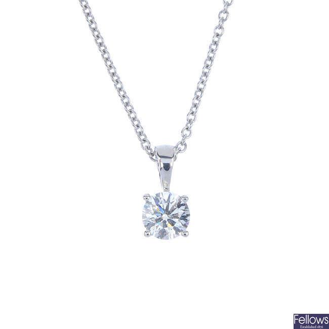 A diamond single-stone pendant.